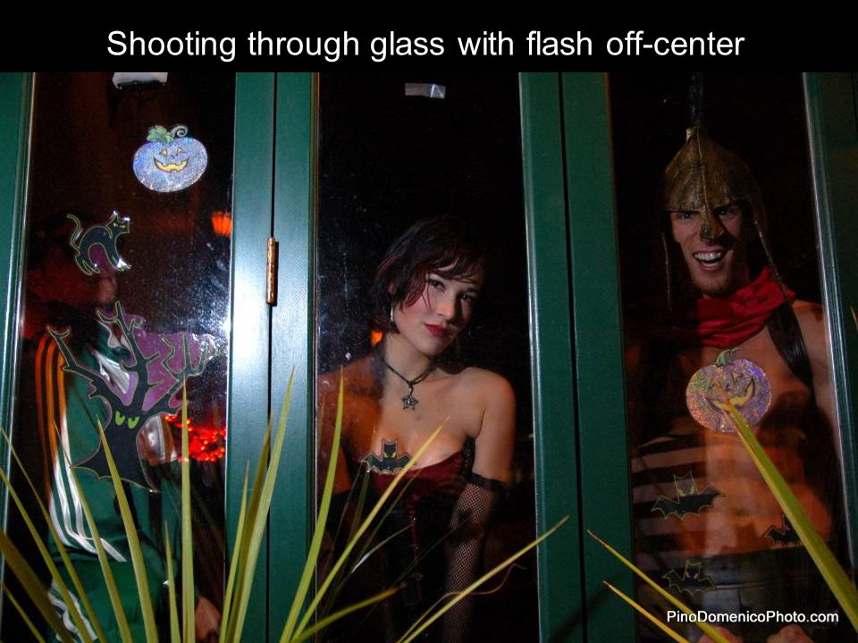 Shooting through glass with flash off-center