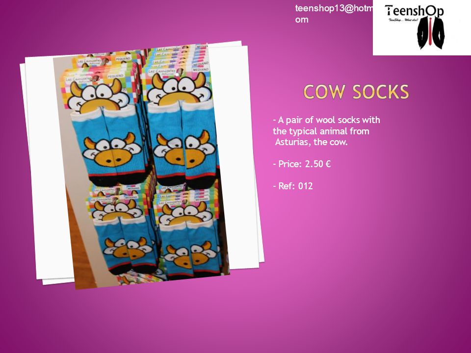 - A pair of wool socks with the typical animal from Asturias, the cow.