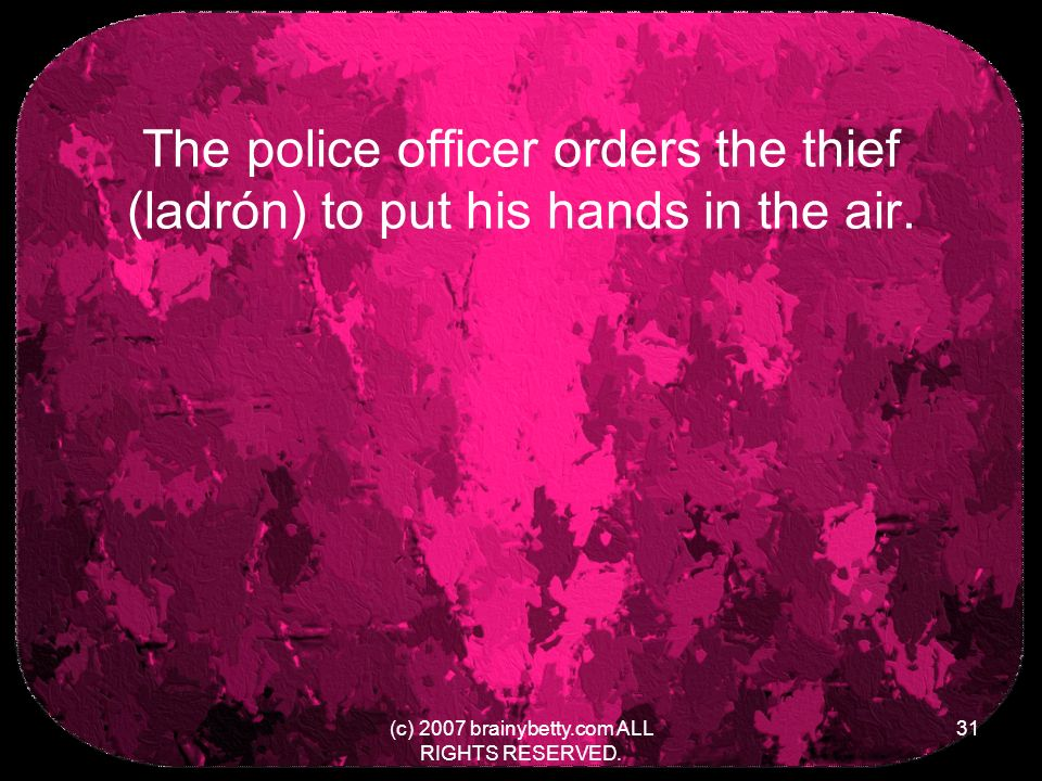The police officer orders the thief (ladrón) to put his hands in the air.