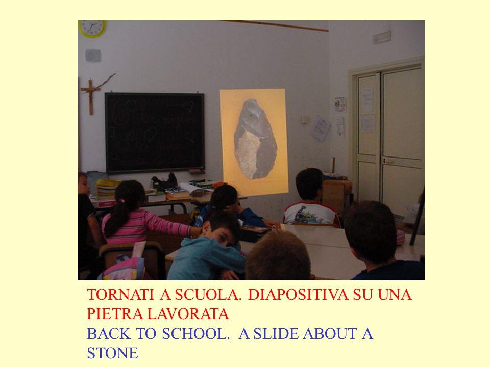 TORNATI A SCUOLA. DIAPOSITIVA SU UNA PIETRA LAVORATA BACK TO SCHOOL. A SLIDE ABOUT A STONE