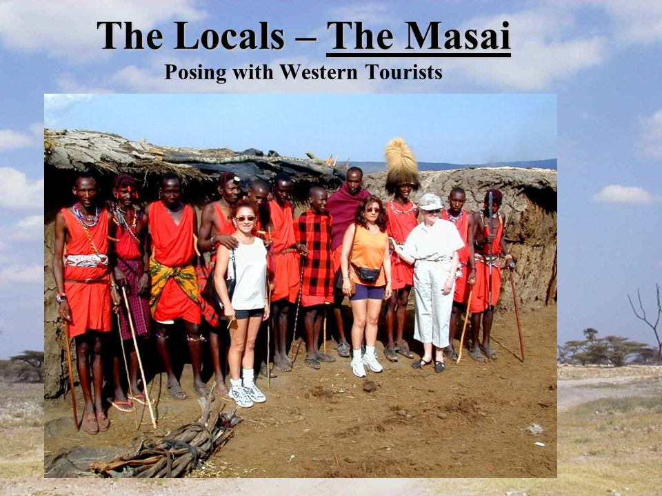 The Locals – The Masai The Locals – The Masai Posing with Western Tourists
