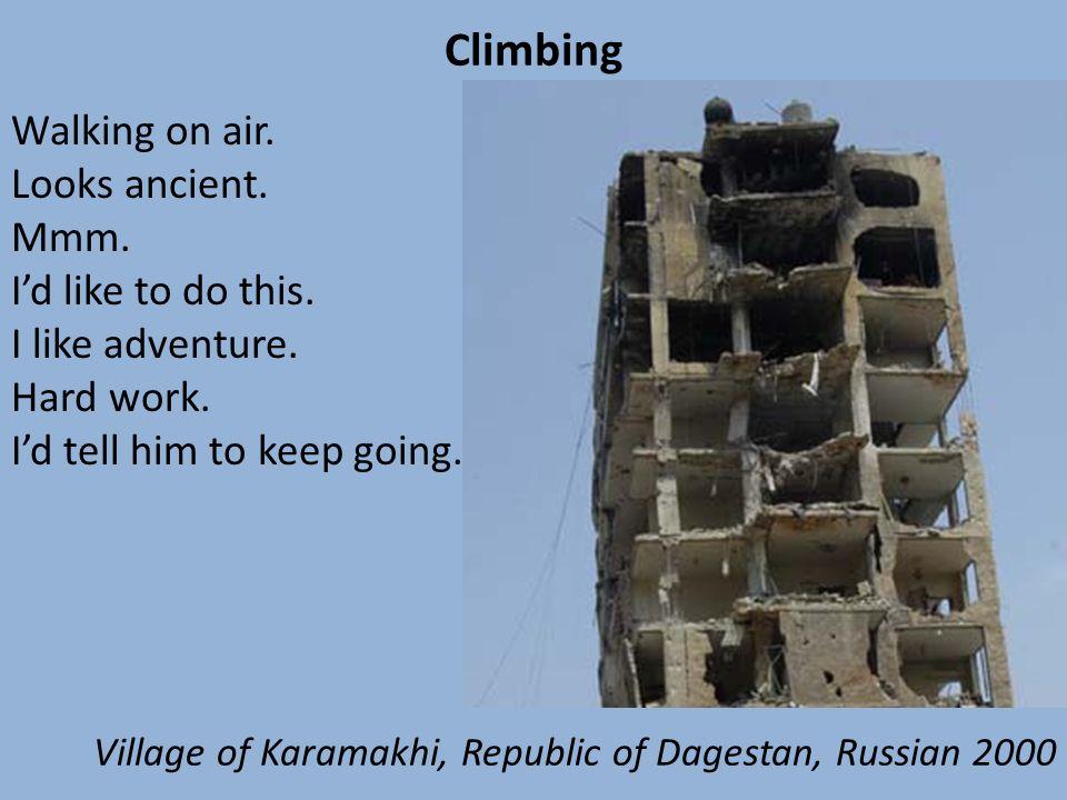 Climbing Walking on air. Looks ancient. Mmm. Id like to do this. I like adventure. Hard work. Id tell him to keep going. Village of Karamakhi, Republi