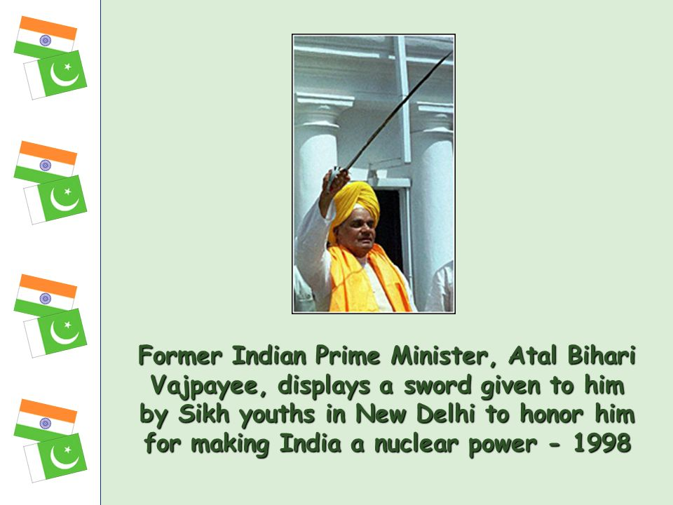 Former Indian Prime Minister, Atal Bihari Vajpayee, displays a sword given to him by Sikh youths in New Delhi to honor him for making India a nuclear
