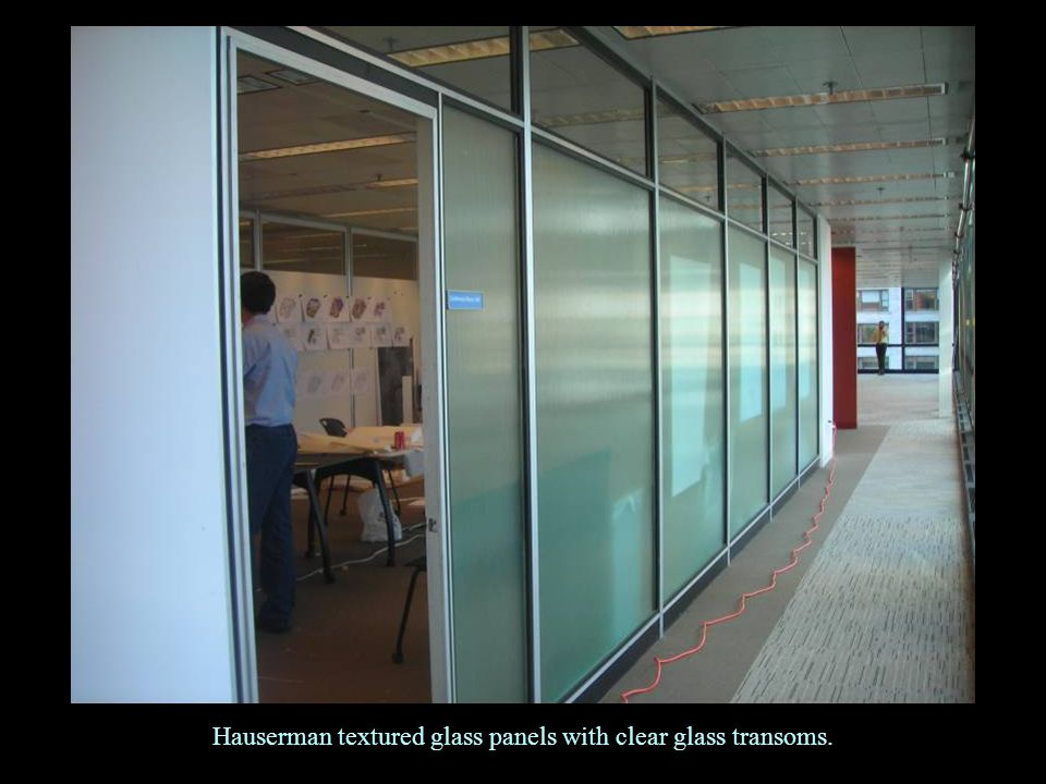 Hauserman textured glass panels with clear glass transoms.