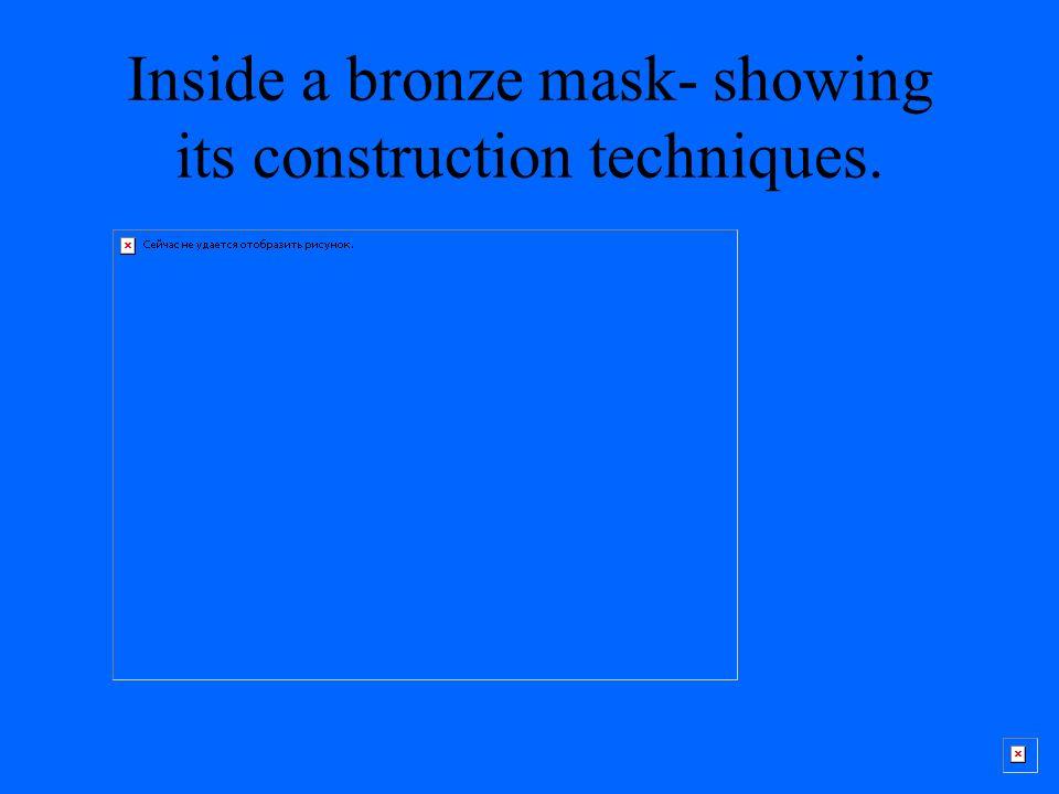 Inside a bronze mask- showing its construction techniques.