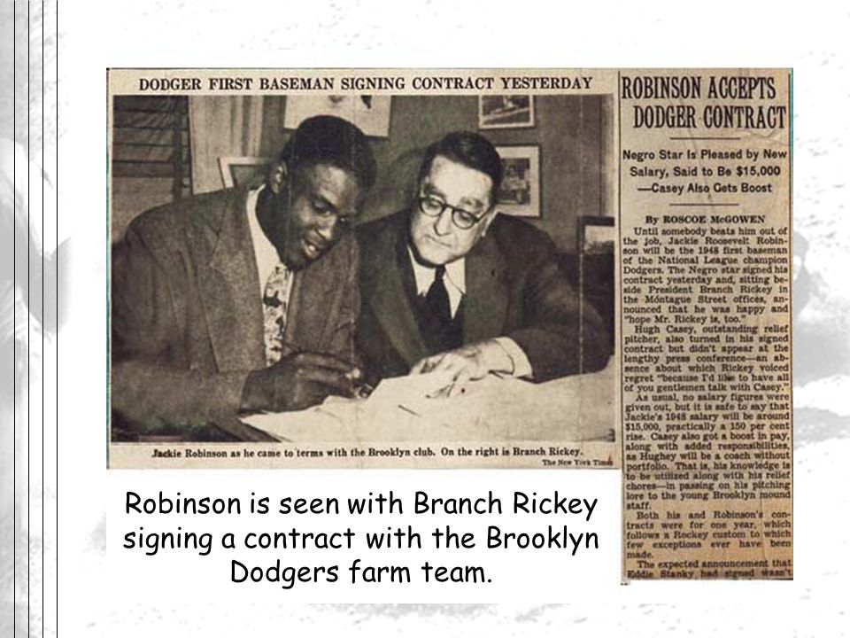 Robinson is seen with Branch Rickey signing a contract with the Brooklyn Dodgers farm team.