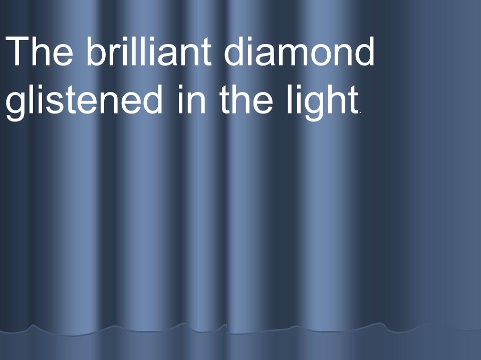 The brilliant diamond glistened in the light.