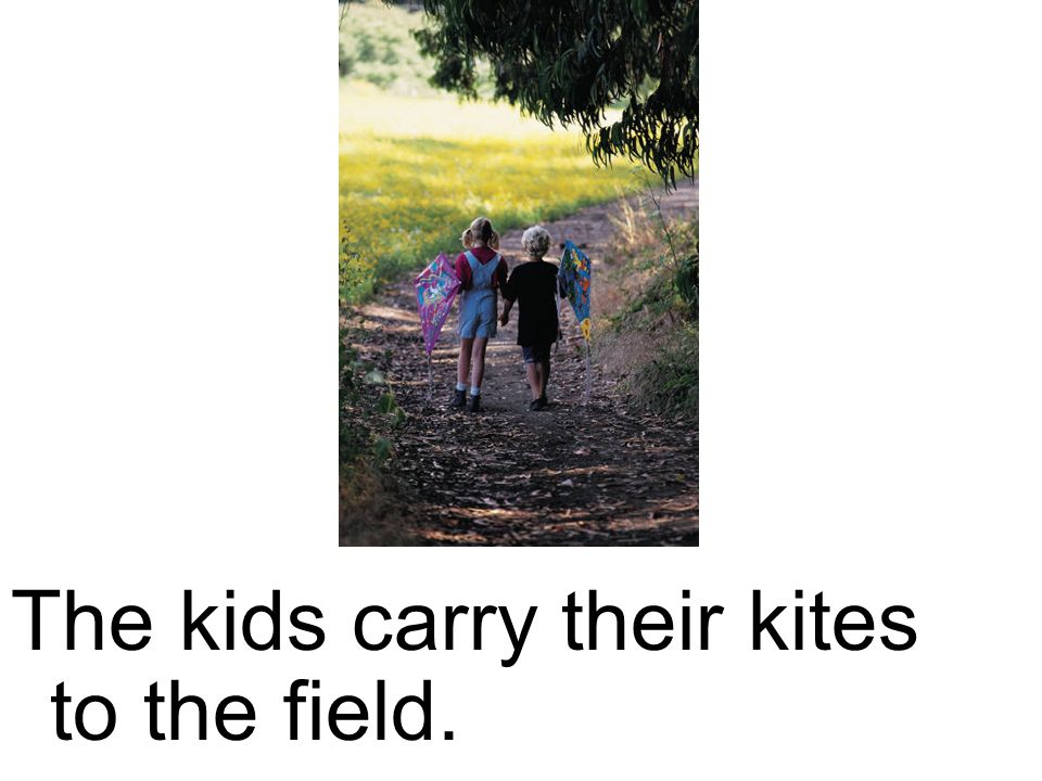 The kids carry their kites to the field.