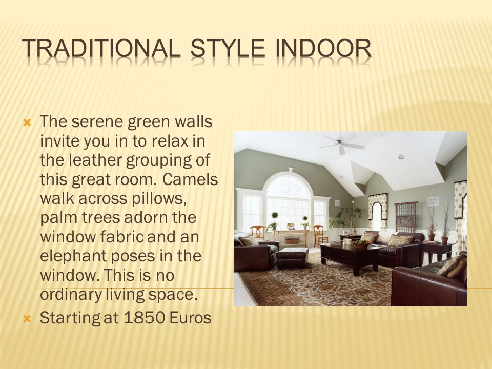 The serene green walls invite you in to relax in the leather grouping of this great room.