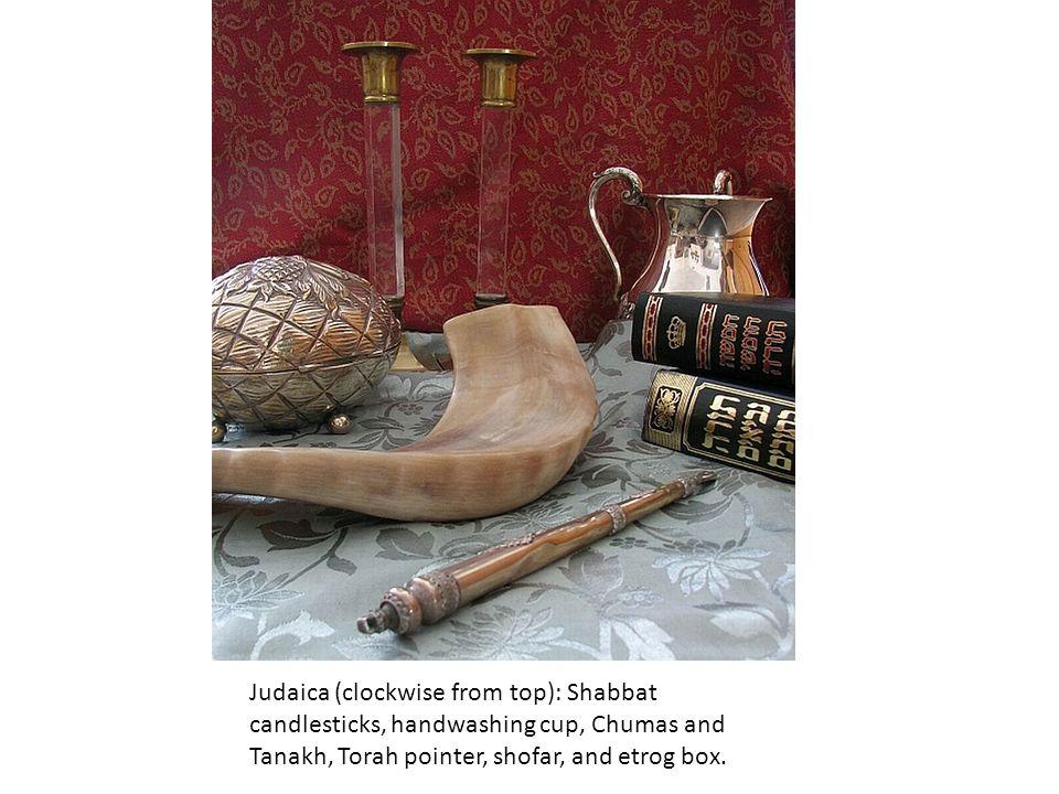 Judaica (clockwise from top): Shabbat candlesticks, handwashing cup, Chumas and Tanakh, Torah pointer, shofar, and etrog box.