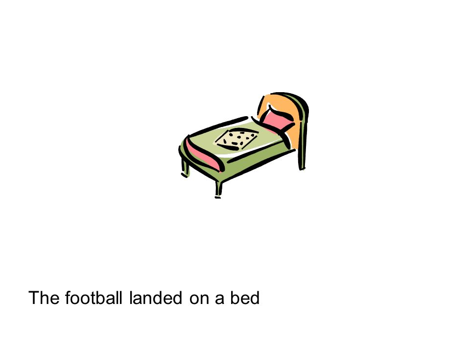 The football landed on a bed