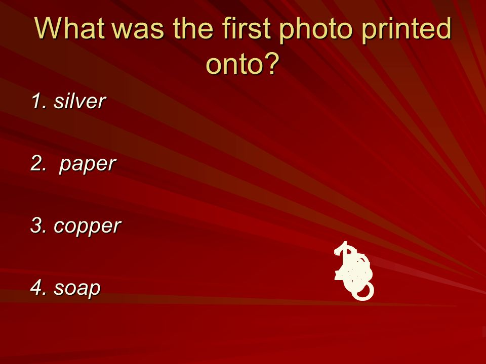 What was the first photo printed onto 1. silver 2. paper 3. copper 4. soap 9 8 7 6 5 4 32 1