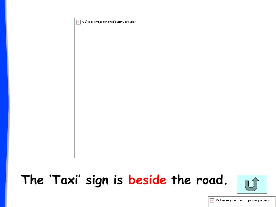 The Taxi sign is beside the road.