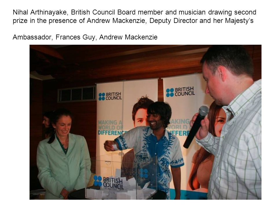 Nihal Arthinayake, British Council Board member and musician drawing second prize in the presence of Andrew Mackenzie, Deputy Director and her Majesty