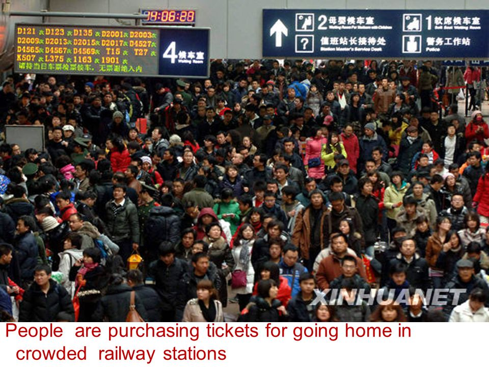 People are purchasing tickets for going home in crowded railway stations