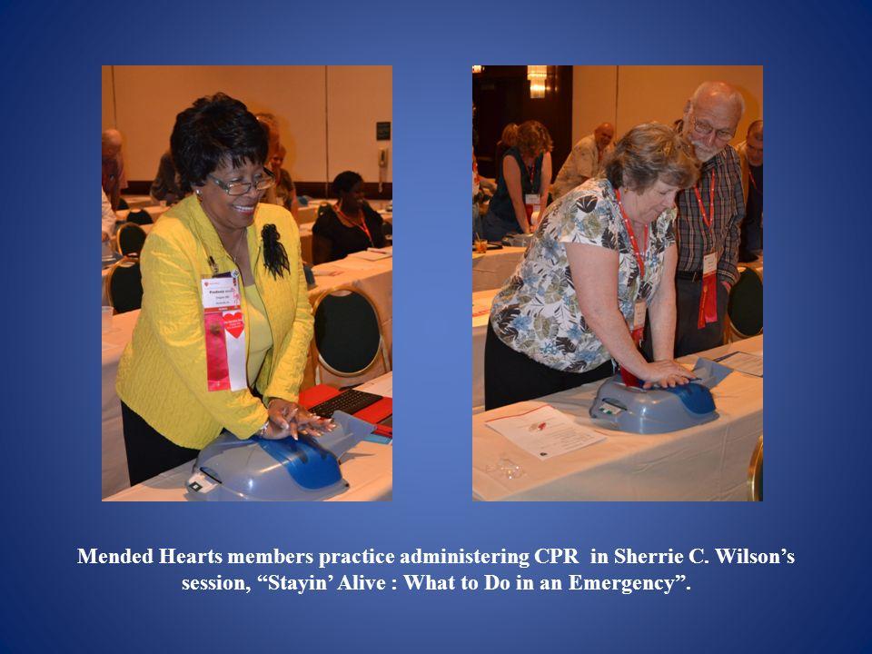 Mended Hearts members practice administering CPR in Sherrie C.