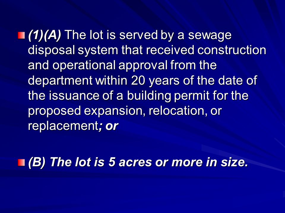 (1)(A) The lot is served by a sewage disposal system that received construction and operational approval from the department within 20 years of the date of the issuance of a building permit for the proposed expansion, relocation, or replacement; or (B) The lot is 5 acres or more in size.