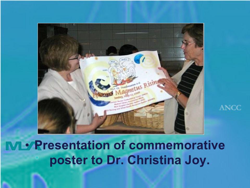 Presentation of commemorative poster to Dr. Christina Joy.