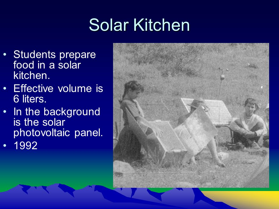 Solar Kitchen Students prepare food in a solar kitchen. Effective volume is 6 liters. In the background is the solar photovoltaic panel. 1992