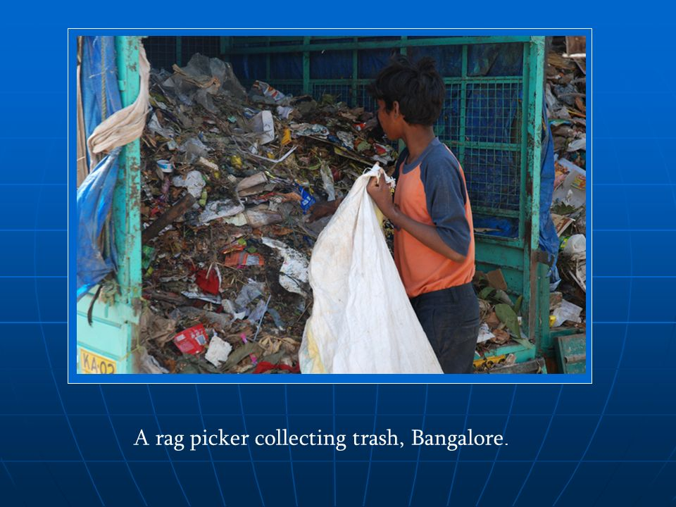 A rag picker collecting trash, Bangalore.
