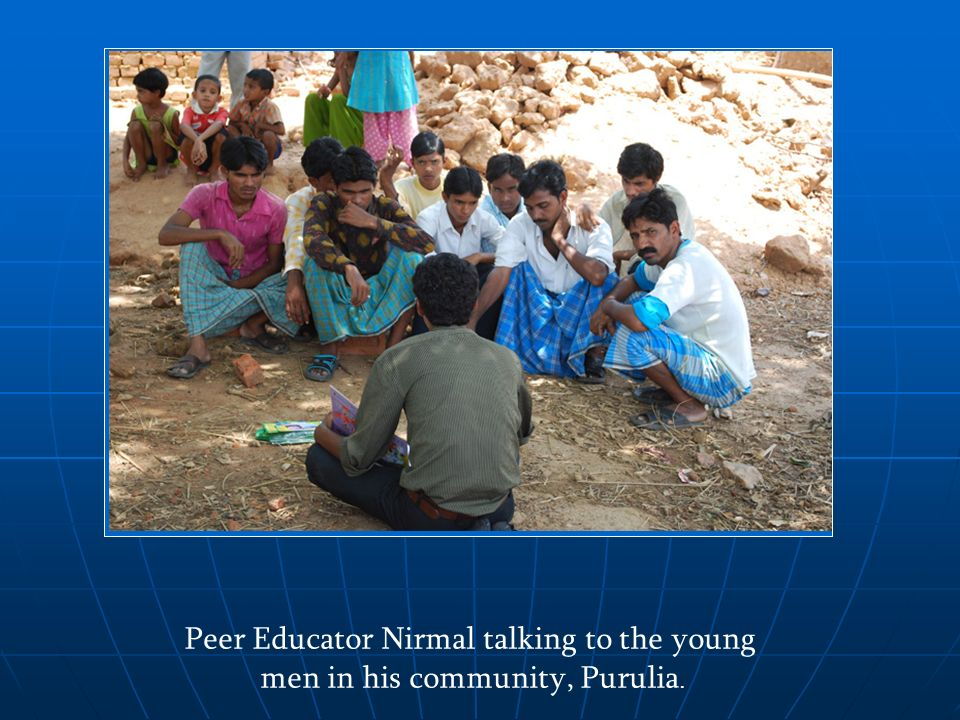 Peer Educator Nirmal talking to the young men in his community, Purulia.