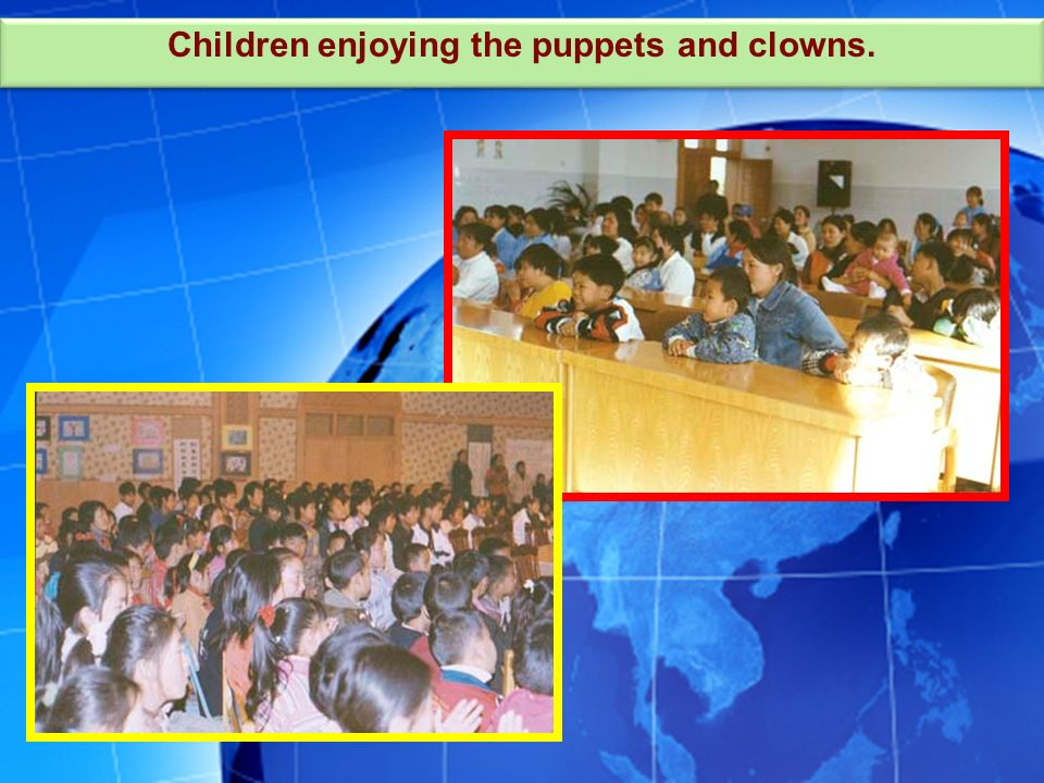 Children enjoying the puppets and clowns.