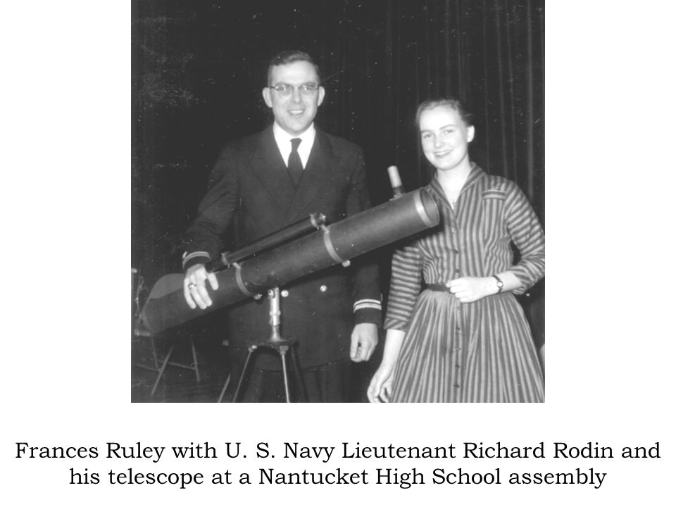 Frances Ruley with U. S. Navy Lieutenant Richard Rodin and his telescope at a Nantucket High School assembly