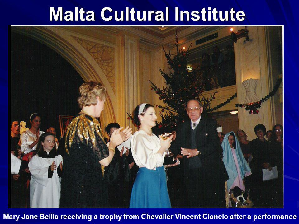 Malta Cultural Institute Mary Jane Bellia receiving a trophy from Chevalier Vincent Ciancio after a performance