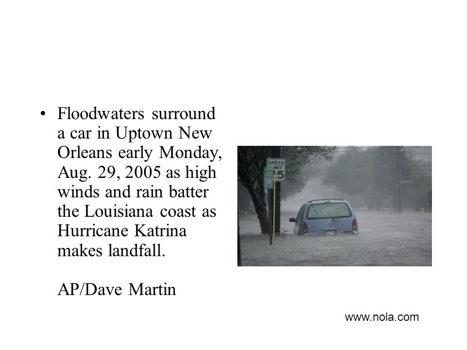 Floodwaters surround a car in Uptown New Orleans early Monday, Aug.