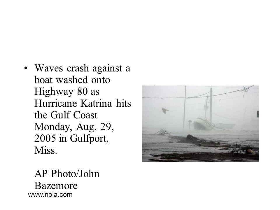 Waves crash against a boat washed onto Highway 80 as Hurricane Katrina hits the Gulf Coast Monday, Aug.