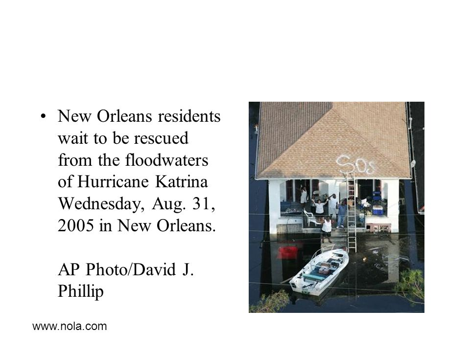 New Orleans residents wait to be rescued from the floodwaters of Hurricane Katrina Wednesday, Aug.