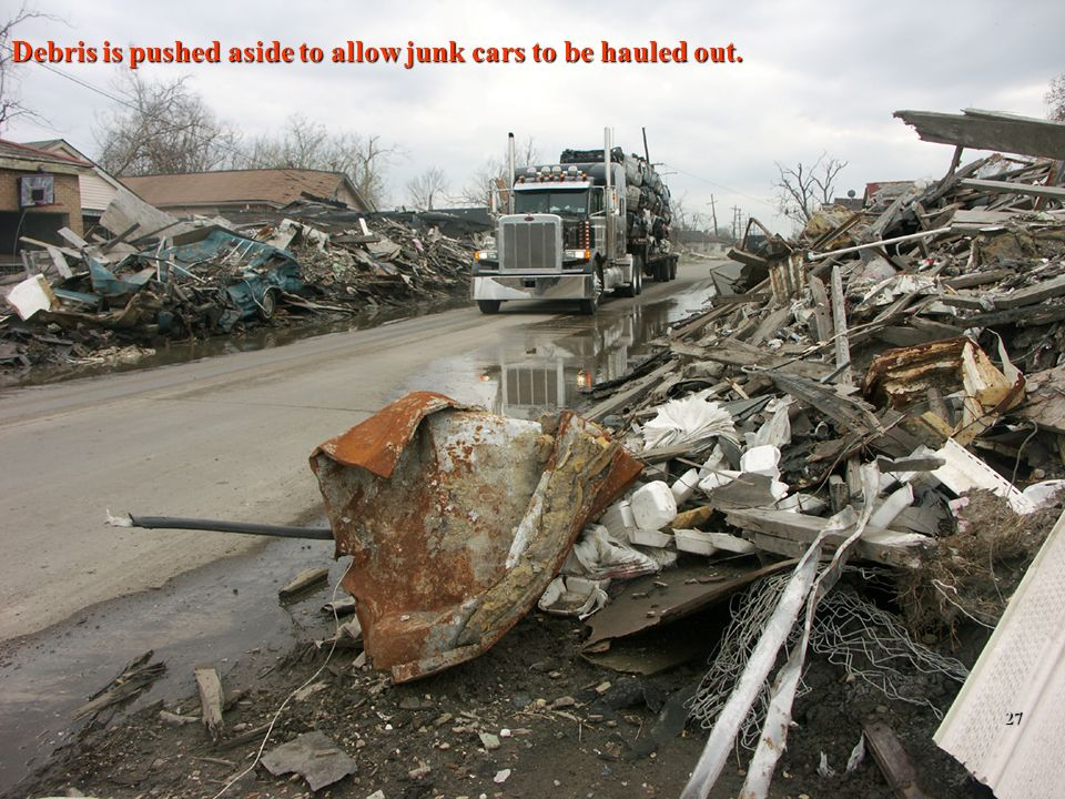 2/12/201427 Debris is pushed aside to allow junk cars to be hauled out. 27