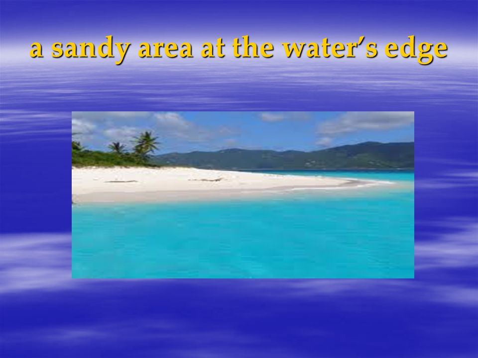 a sandy area at the waters edge