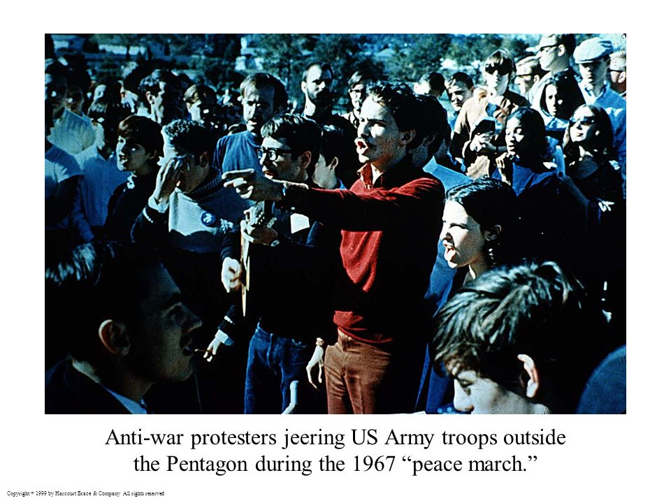 Anti-war protesters jeering US Army troops outside the Pentagon during the 1967 peace march.