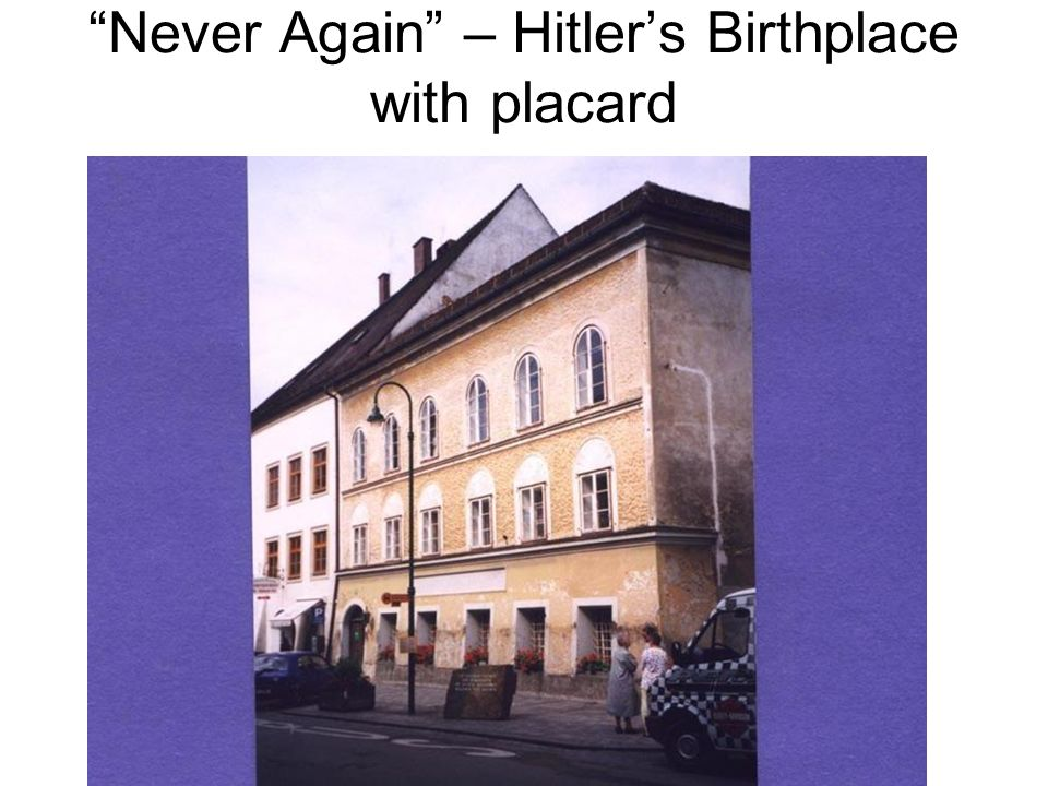 Never Again – Hitlers Birthplace with placard