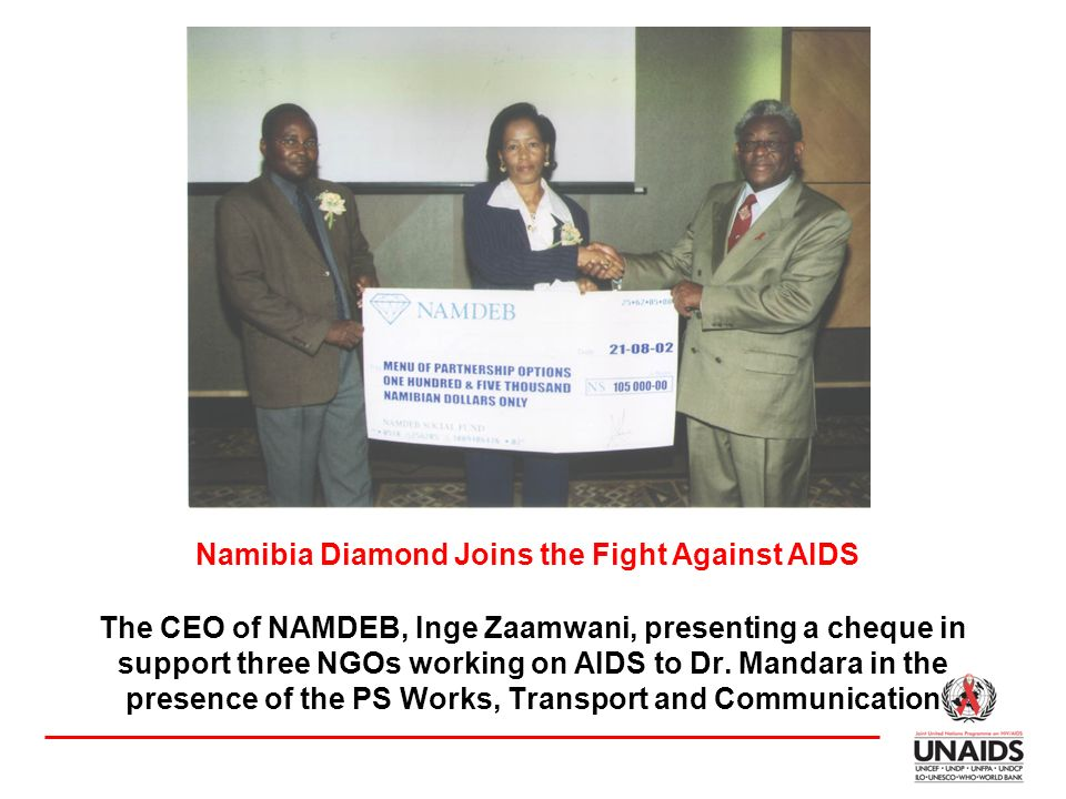 The CEO of NAMDEB, Inge Zaamwani, presenting a cheque in support three NGOs working on AIDS to Dr.