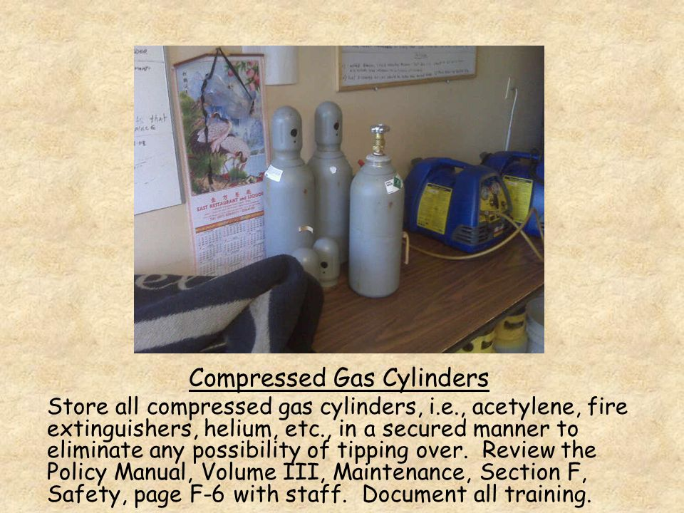 Compressed Gas Cylinders Store all compressed gas cylinders, i.e., acetylene, fire extinguishers, helium, etc., in a secured manner to eliminate any possibility of tipping over.