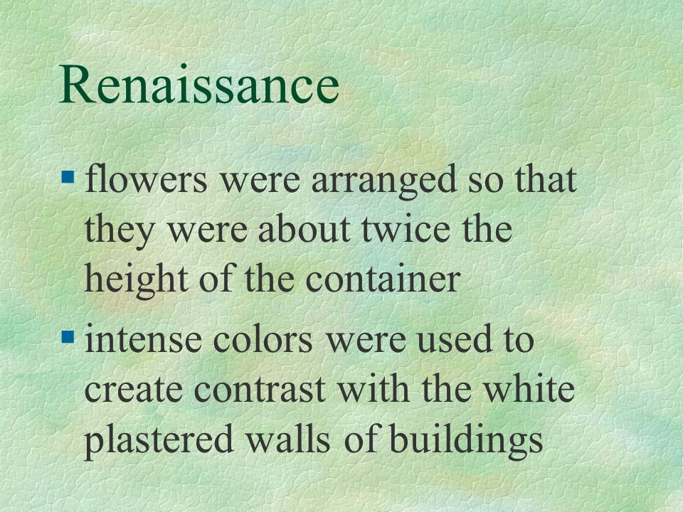 Renaissance §flowers were arranged so that they were about twice the height of the container §intense colors were used to create contrast with the whi