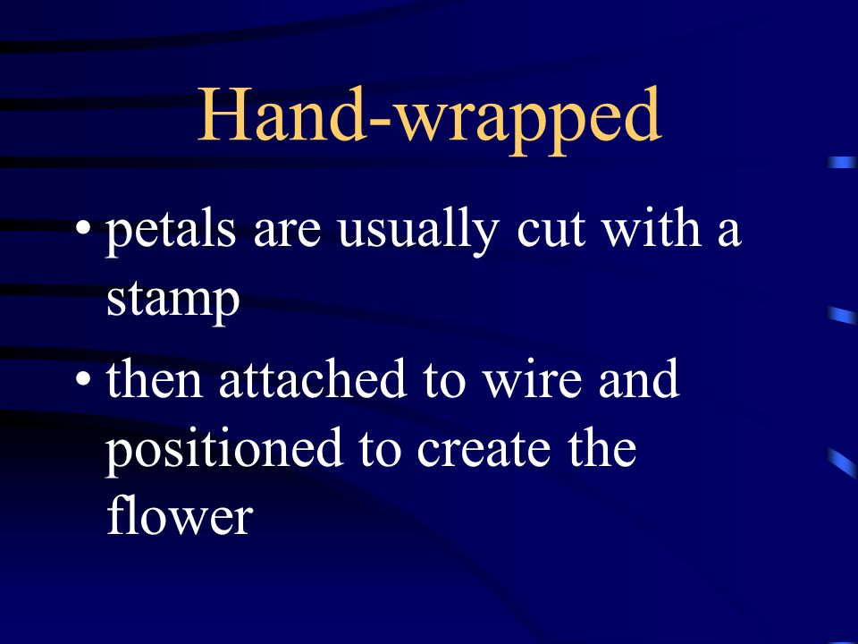 Hand-wrapped petals are usually cut with a stamp then attached to wire and positioned to create the flower