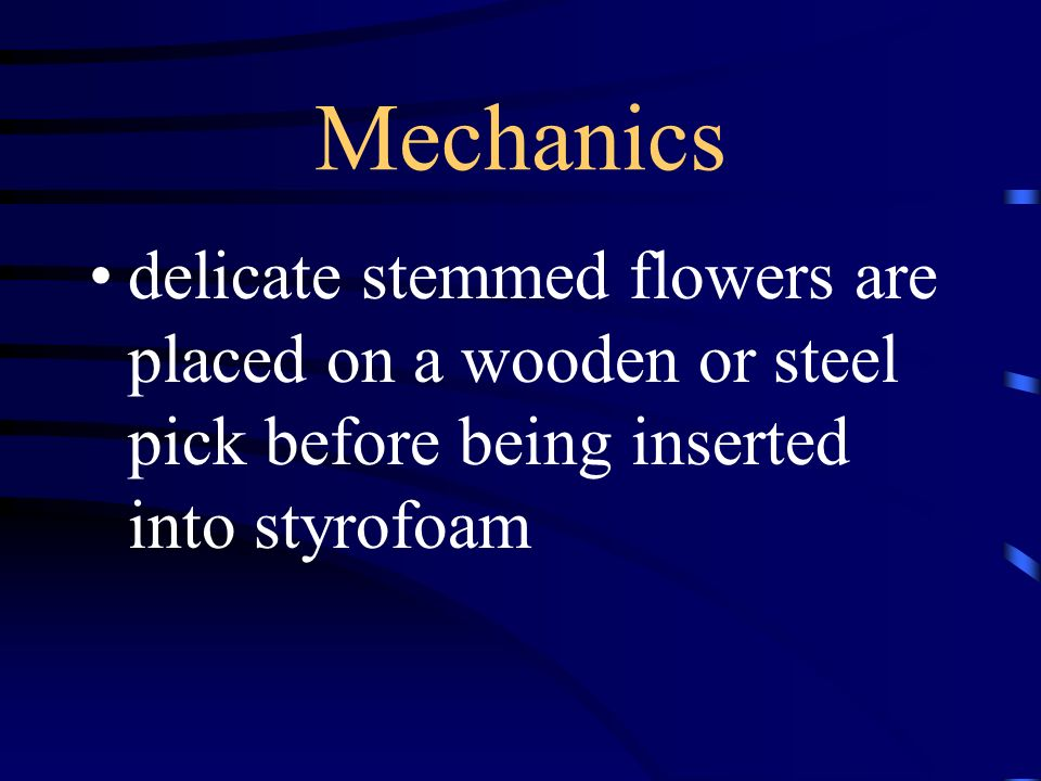 Mechanics delicate stemmed flowers are placed on a wooden or steel pick before being inserted into styrofoam