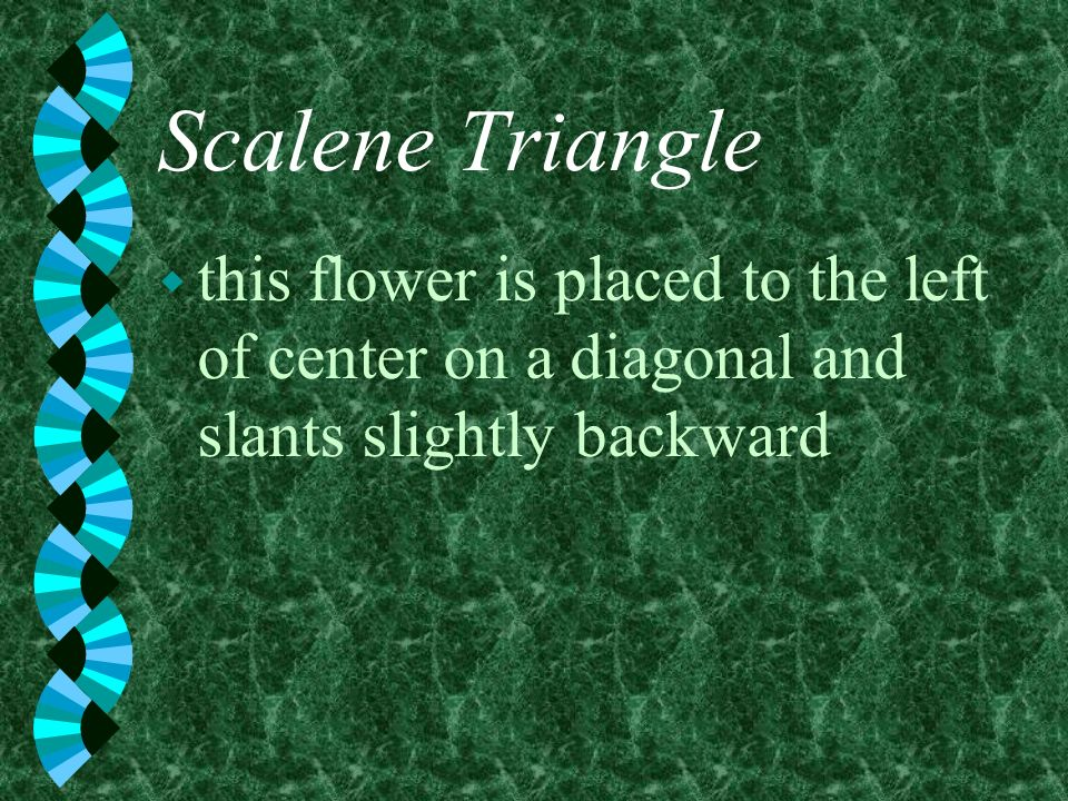 Scalene Triangle w this flower is placed to the left of center on a diagonal and slants slightly backward