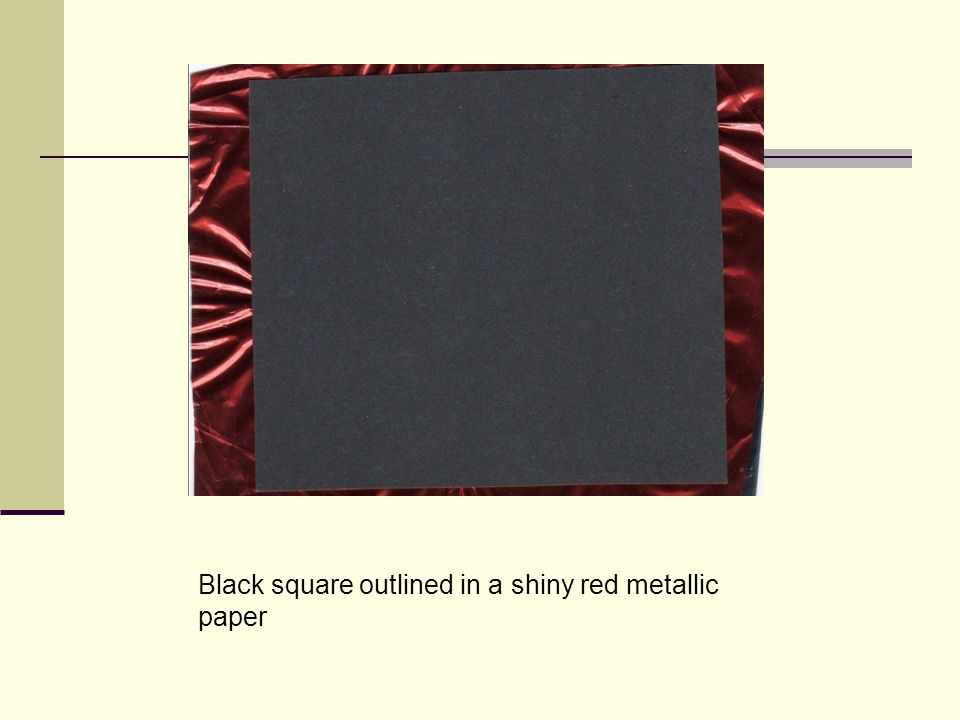 Black square outlined in a shiny red metallic paper