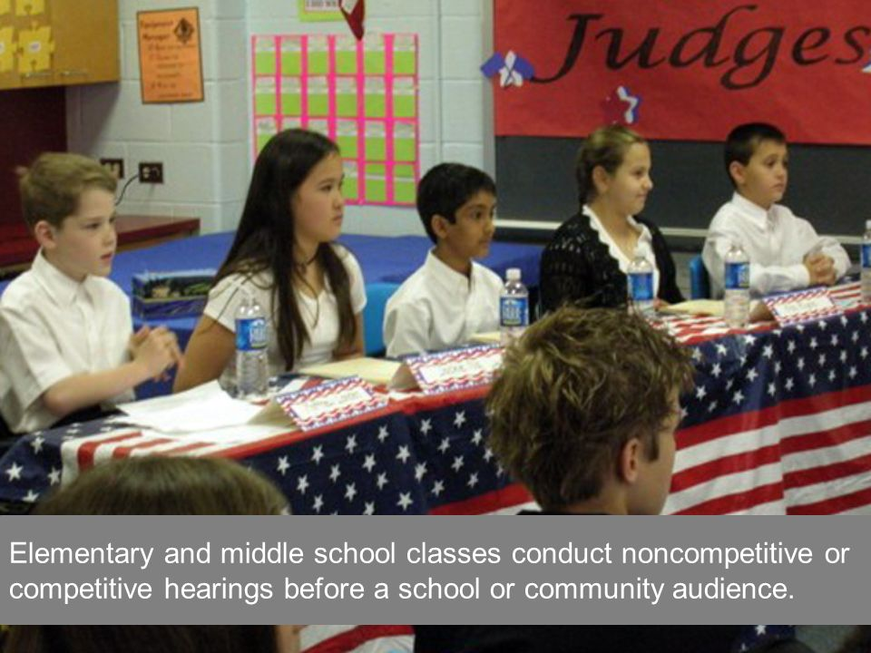 Elementary and middle school classes conduct noncompetitive or competitive hearings before a school or community audience.