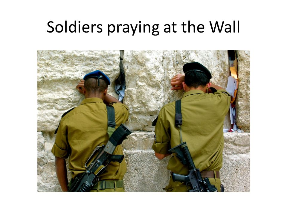 Soldiers praying at the Wall