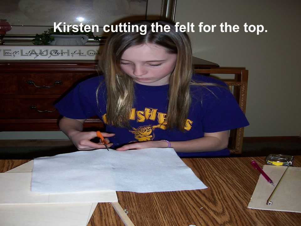 Kirsten cutting the felt for the top.