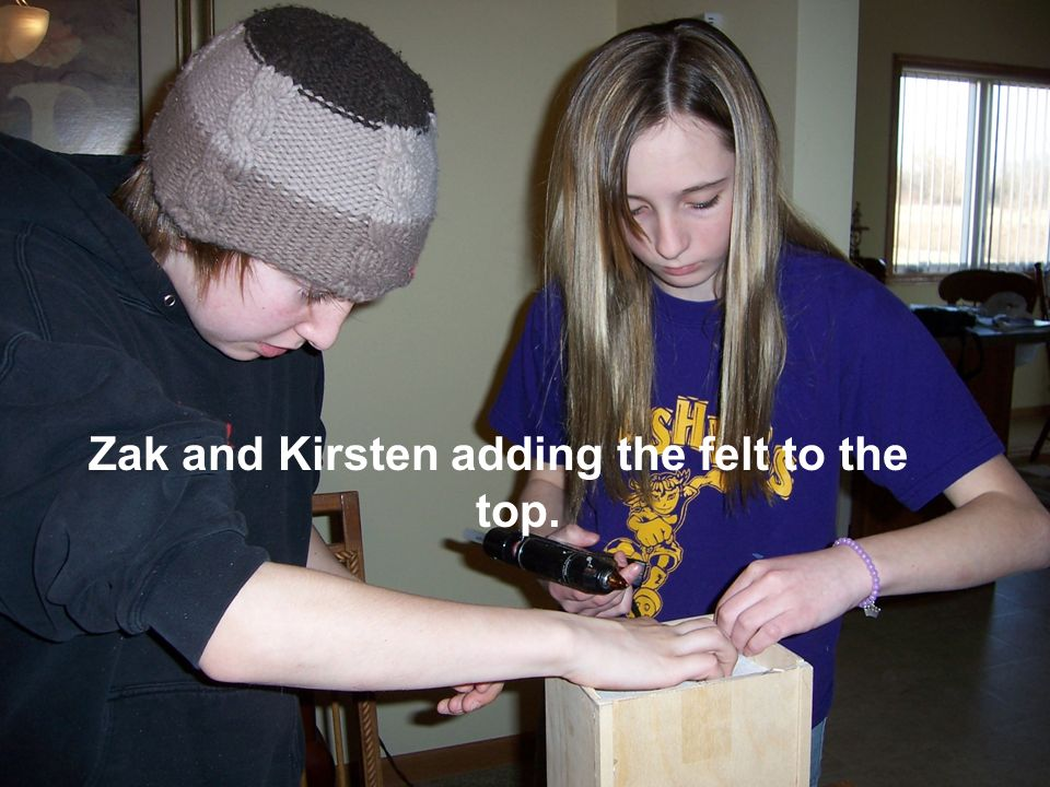 Zak and Kirsten adding the felt to the top.