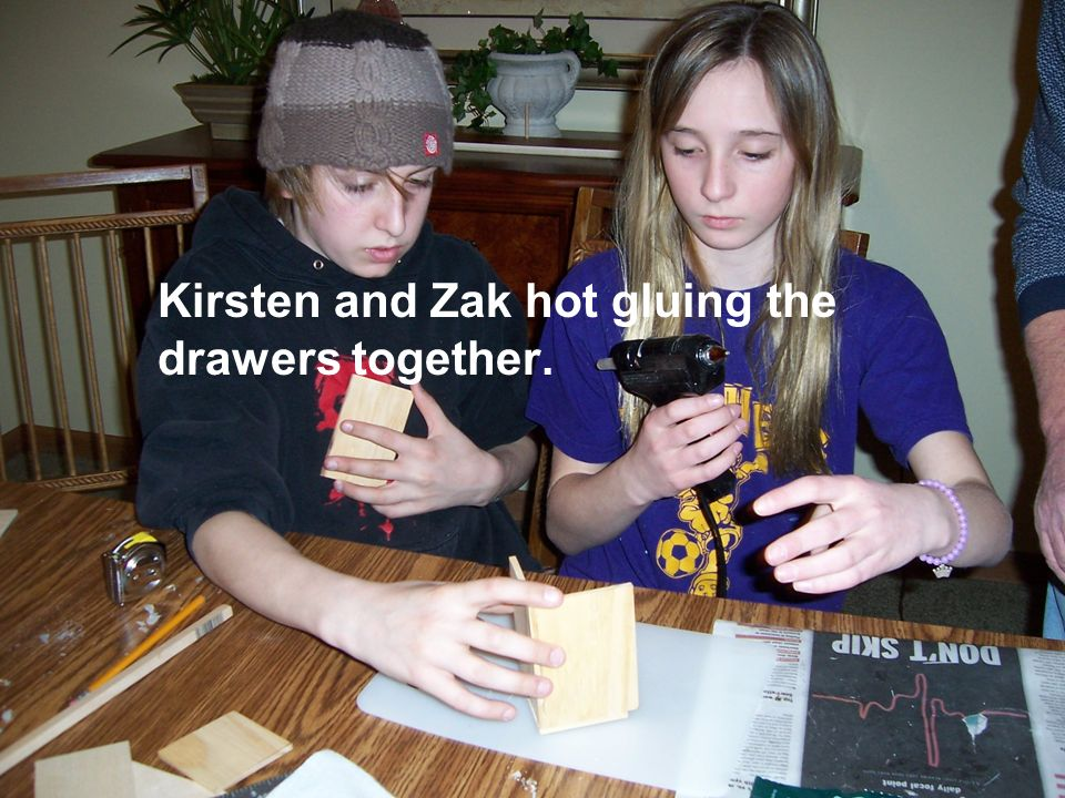 Kirsten and Zak hot gluing the drawers together.