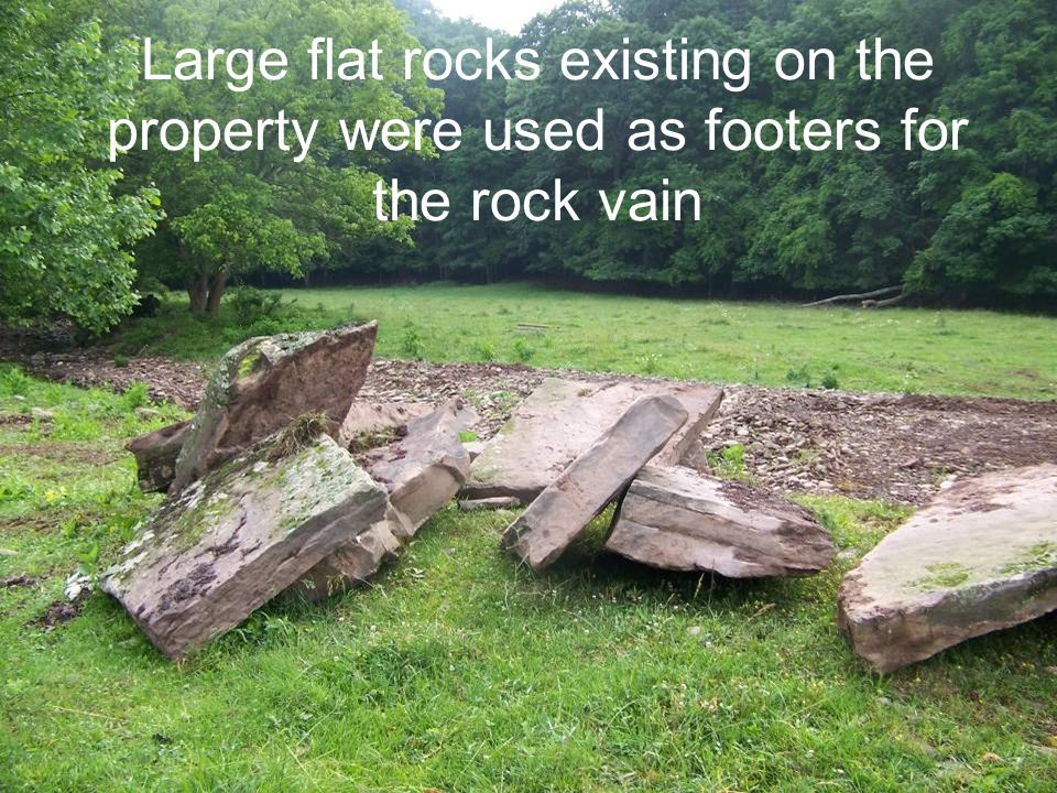 Large flat rocks existing on the property were used as footers for the rock vain