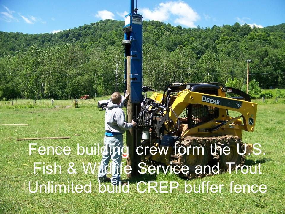 Fence building crew form the U.S. Fish & Wildlife Service and Trout Unlimited build CREP buffer fence