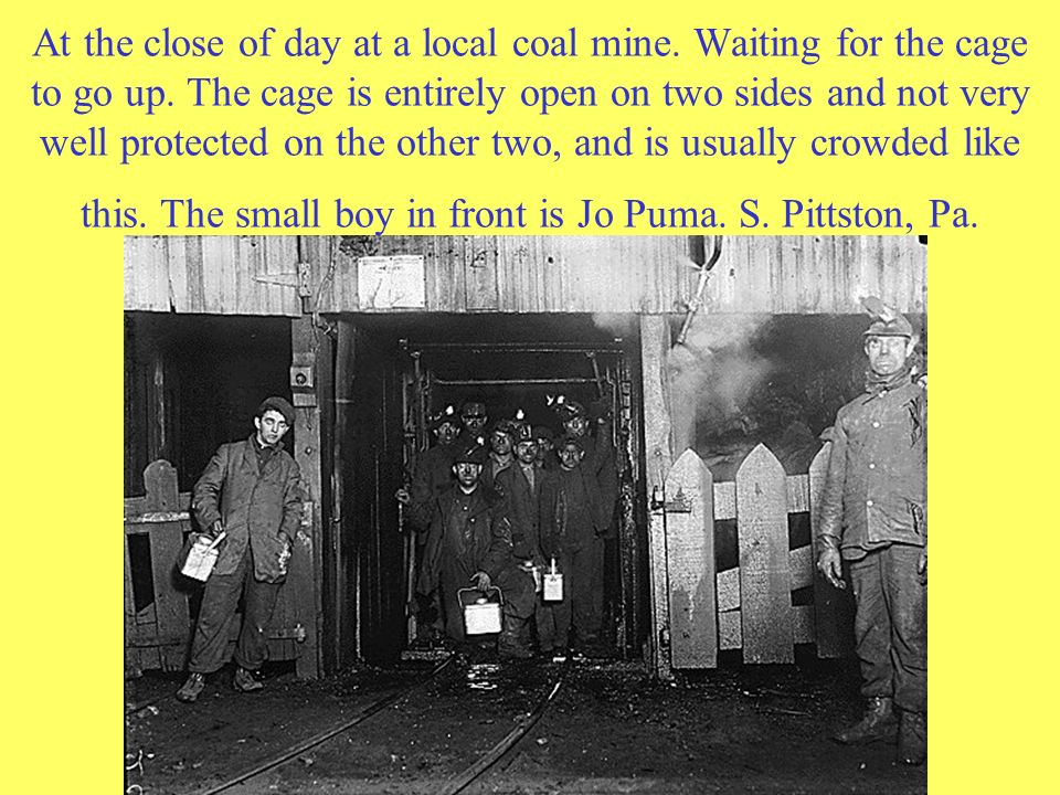 At the close of day at a local coal mine. Waiting for the cage to go up. The cage is entirely open on two sides and not very well protected on the oth